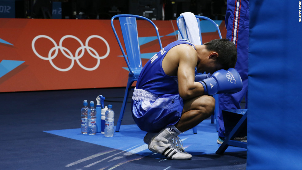 Thailand's Kaeo Pongprayoon has a quiet moment before entering the ring in the men's light flyweight (48-kilogram) boxing semifinals.