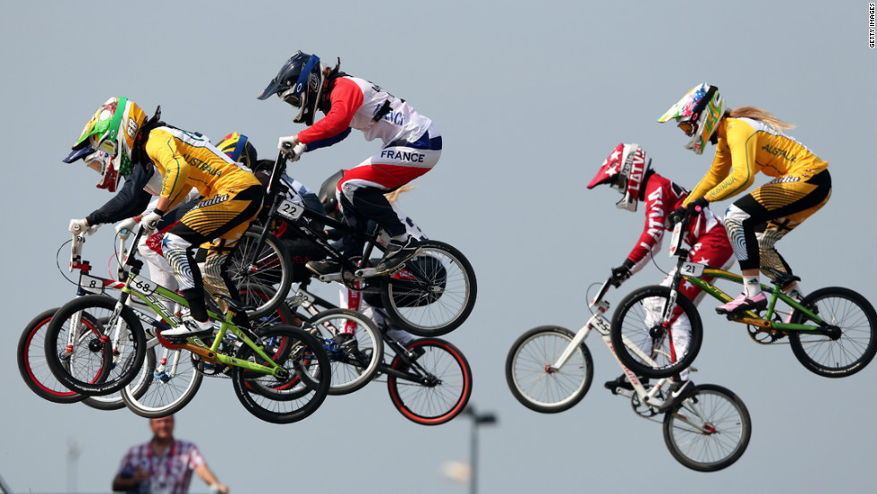 Cyclists make a jump during the women's BMX cycling semifinals.