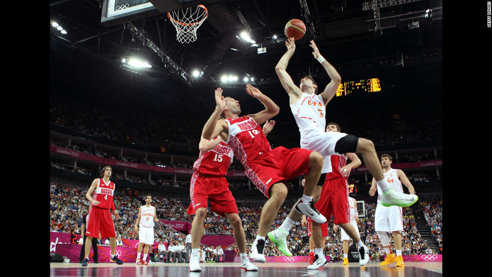 No. 15 Rudy Fernandez goes up for a shot against No. 12 Sergey Monya of Russia in the first half during the men's basketball semifinal match.