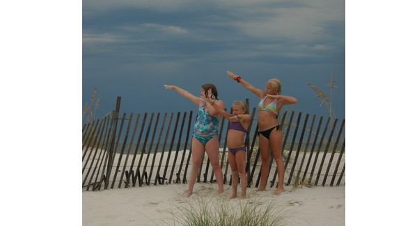 """While on vacation to Gulf Shores, AL, Amanda Davis says she asked her daughters to strike a pose for the camera and they spontaneously did the signature 'Bolt' pose. """"Just like planking or Tebowing, it's just plain fun,"""" she says. """"My oldest daughter loves track and thinks Usain Bolt is an amazing and talented athlete."""""""