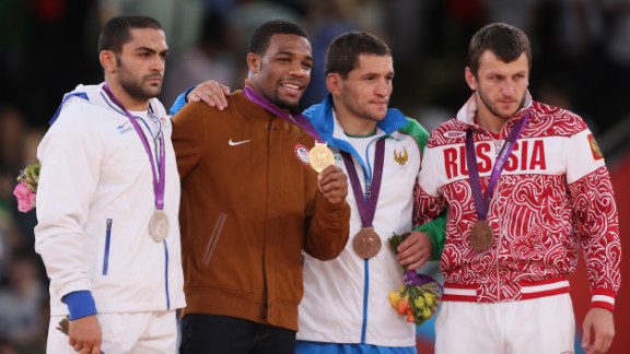 From left to right: Silver medalist Sadegh Saeed Goudarzi of Iran,  gold medalist Jordan Ernest Burroughs of the U.S. and bronze medalists  Soslan Tigiev of Uzbekistan and Denis Tsargush of Russia on the podium of the men