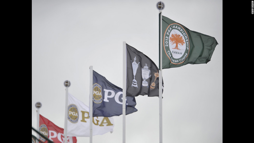 The wind whips the PGA flags on Friday.