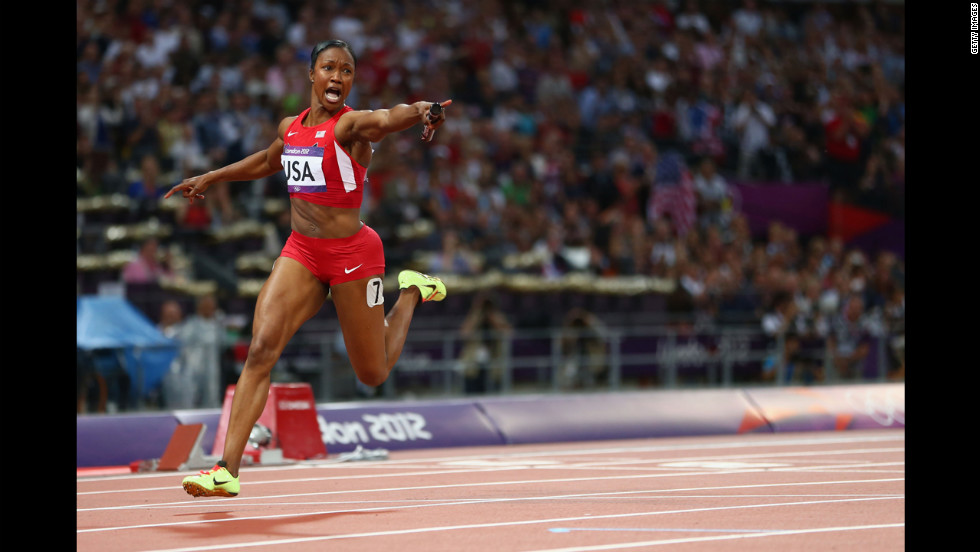 Carmelita Jeter of the United States celebrates winning gold in the women's 4x100-meter relay.