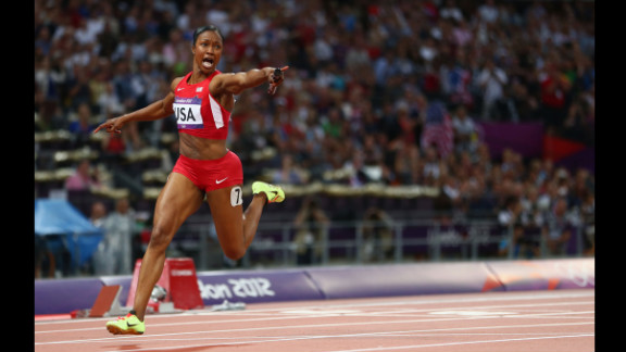 Carmelita Jeter of the United States celebrates winning gold in the women