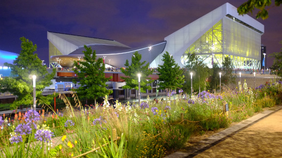 The Aquatic Centre shone neon yellow beyond wildflower planting on the banks of the River Lea. The venue