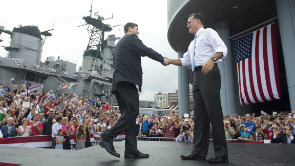 Romney and Ryan shake hands as they embark on a four-day, four-state bus tour through Virginia, North Carolina, Florida and Ohio.