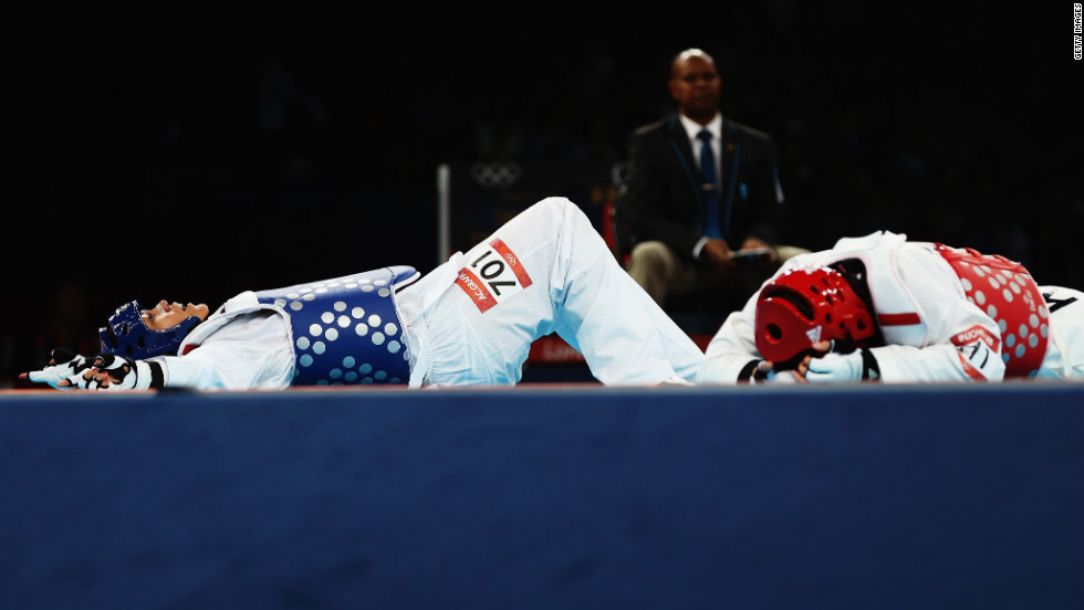 French fighter Anne-Caroline Graffe, right, reacts after her win over South Korean fighter In Jong Lee during the women's taekwondo quarterfinal match.