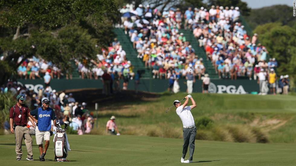 Justin Rose of England hits a shot off the first fairway during round three on Saturday.