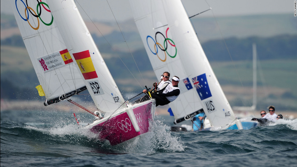 Tamara Echegoyen Dominguez, Sofia Toro Prieto Puga and Angela Pumariega Menendez of Spain lead from Olivia Price, Nina Curtis and Lucinda Whitty of Australia as they compete in women's sailing.