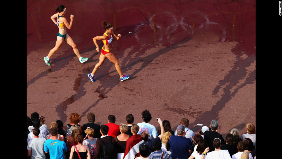 Spain's Beatriz Pascual races Australia's Regan Lamble during the women's 20-kilometer walk.