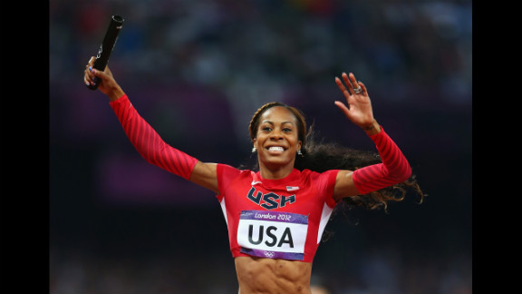 Sanya Richards-Ross of crosses the finish line to win gold for her team.