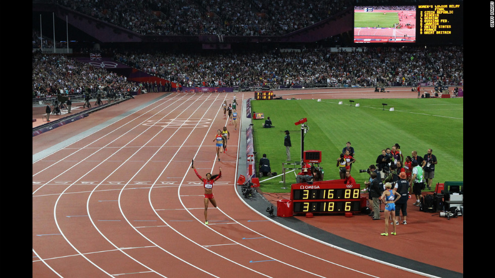 Sanya Richards-Ross of the United States is triumphant as she crosses the finish line.