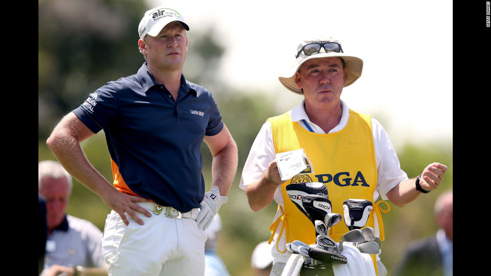 Jamie Donaldson of Wales, left, and his caddie Mick Donaghy look on from the first tee.