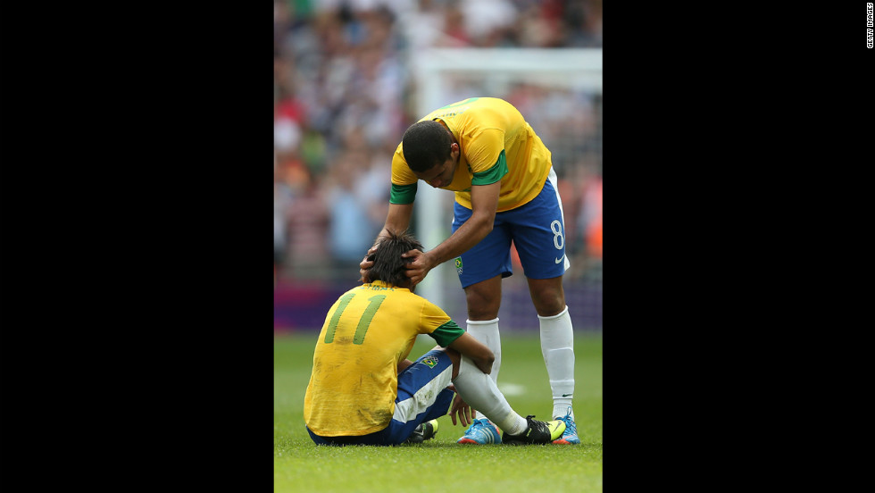 Brazilian soccer player Romulo adjusts a teammate's head with some on-field chiropractic.