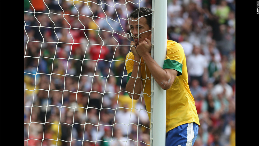 Leandro Damiao of Brazil waits for his mother to let him out of timeout.