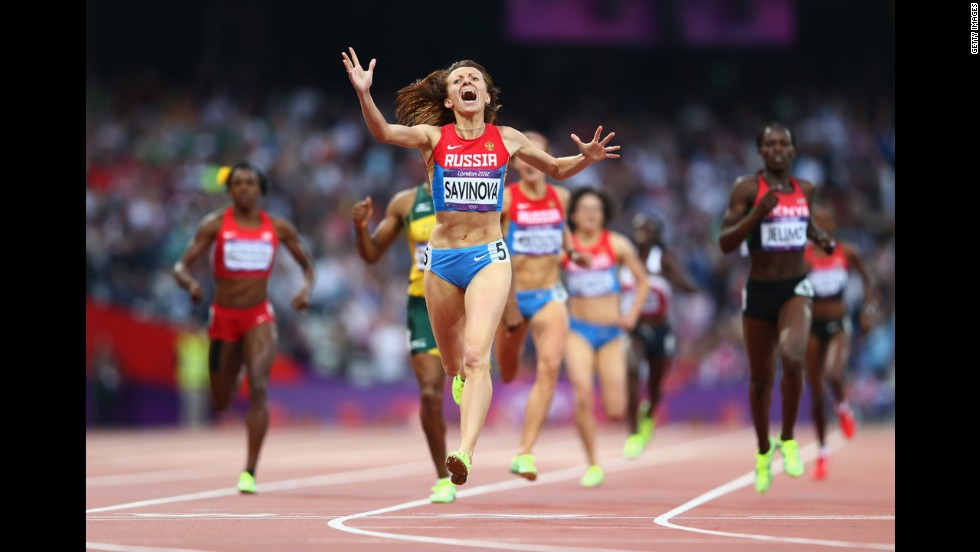 Mariya Savinova of Russia celebrates as she crosses the finish line to win gold in the women's 800-meter final.