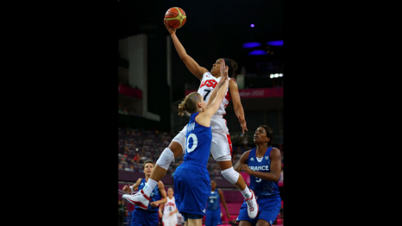 Maya Moore, in white, leaps for the basket against France