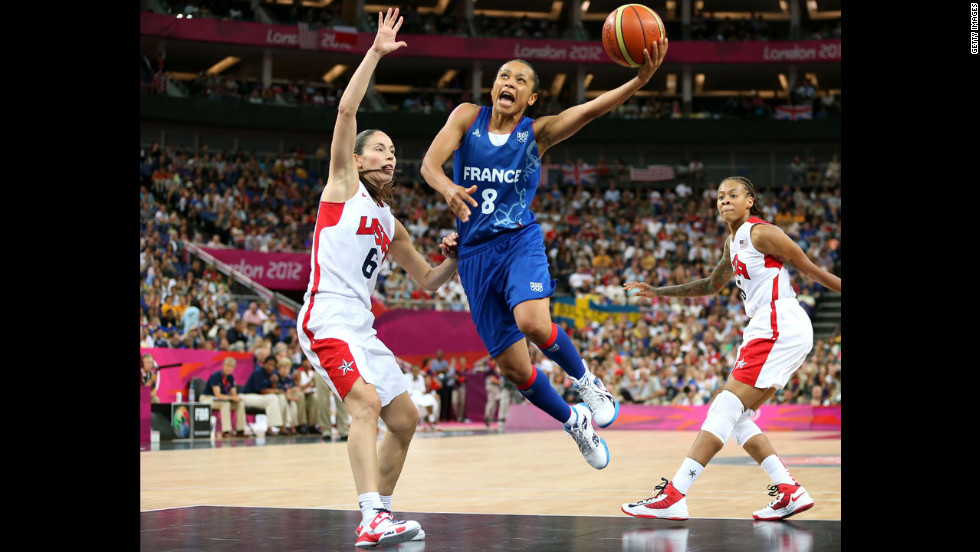 France's Edwige Lawson-Wade, in blue, goes up for a shot against Sue Bird in the second half.