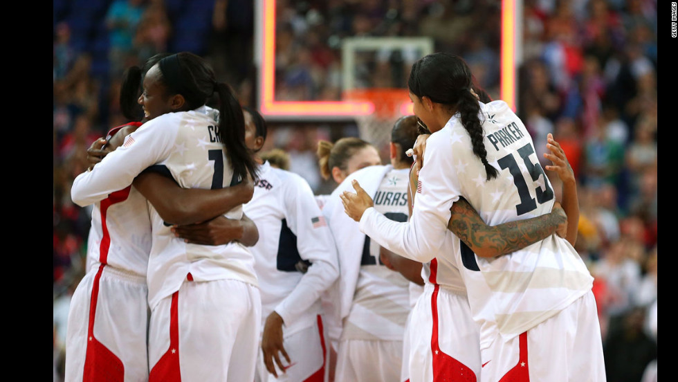 Members of the U.S. women's basketball team hug after defeating France.
