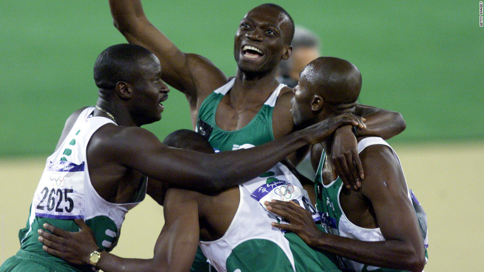 The Nigerian 4x400m team celebrate their silver medal at the 2000 Games.  From left to right: Sunday Bada, Enefiok Udo-Obong, Jude Monye and Clement Chukwu. The team would later be pronounced winners after the disqualification of Team USA.