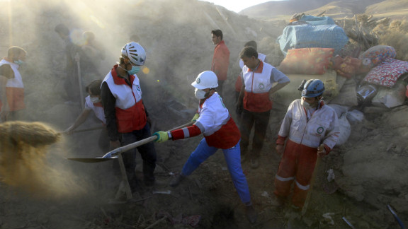 Rescue teams search for victims in the rubble of destroyed buildings.