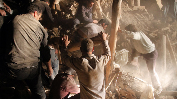 Residents and rescue workers sift through the rubble to find any survivors and recover victims of the earthquakes near the town of Varzaqan.