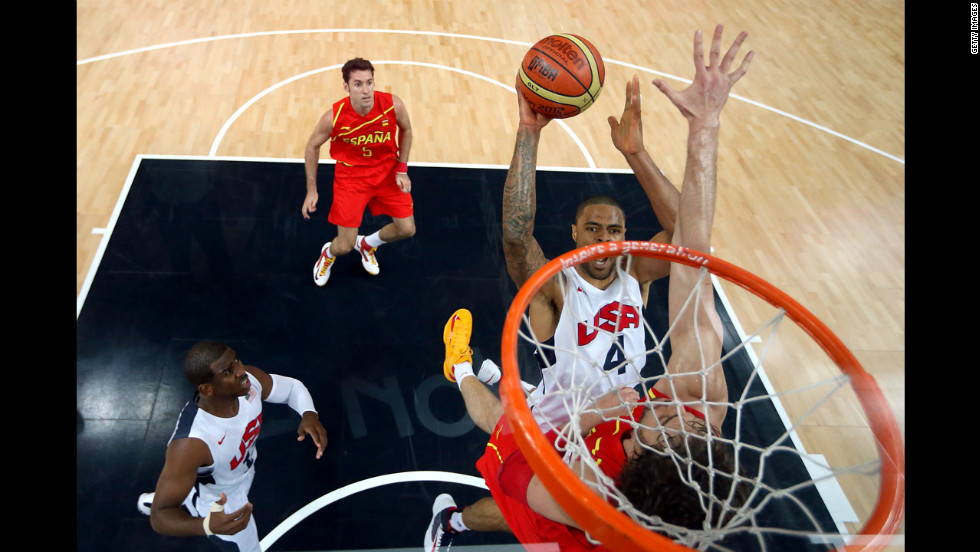 Tyson Chandler takes the ball to the hoop in the men's basketball gold medal game between the United States and Spain at North Greenwich Arena in London.