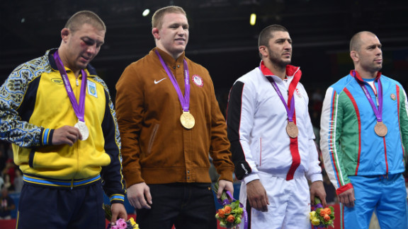 Standing on the podium after receiving their medals are, left to right, silver medalist  Andriitsev, gold medalist  Varner and bronze medalists George Gogshelidze of Georgia and Khetag Gazyumov of Azerbaijan.
