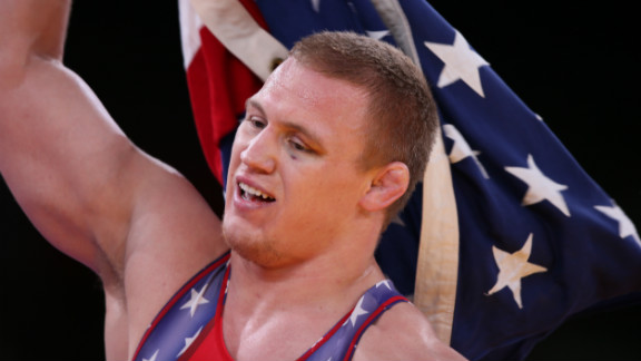 U.S. wrestler Jacob Varner waves the Stars and Stripes after winning the gold medal in the men