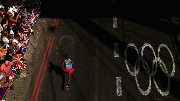 """Yonas Kifle of Eritrea is cheered by spectators as he competes in the men's marathon on day 16 of the London 2012 Olympics, Sunday, August 12, the last day of the Games. See all the action as it unfolded here, and <a href=""""http://www.cnn.com/2012/08/11/worldsport/gallery/olympics-day-fifteen/index.html"""">check out the best images from day 15 of competition</a> on Saturday, August 11."""