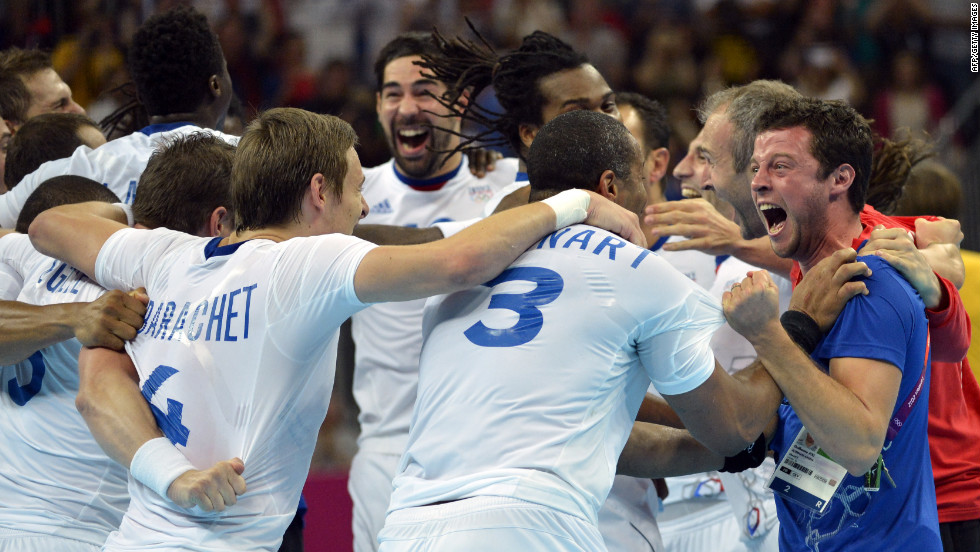 France's players are joyous after winning the men's gold medal handball match between Sweden and France.