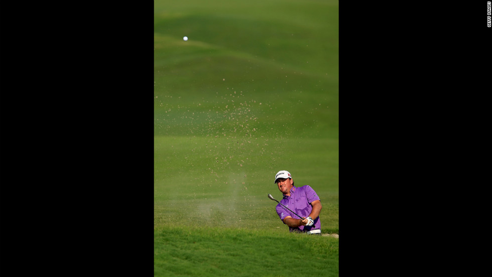 Graeme McDowell of Northern Ireland hits out of a bunker on the 18th hole during round three.