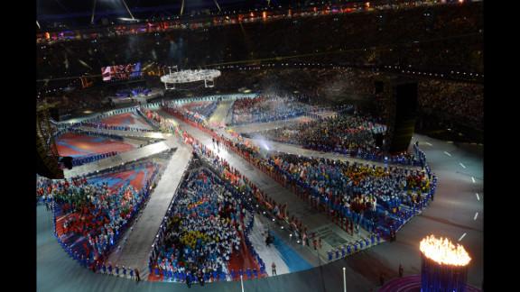Athletes form a living Union Jack on the floor of Olympic stadium.