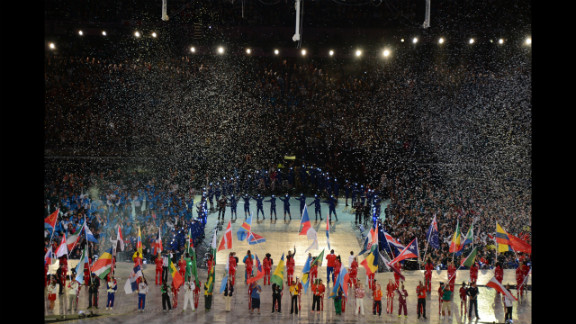 Flagbearers carry the flags of the 204 countries that participated in the Olympics.