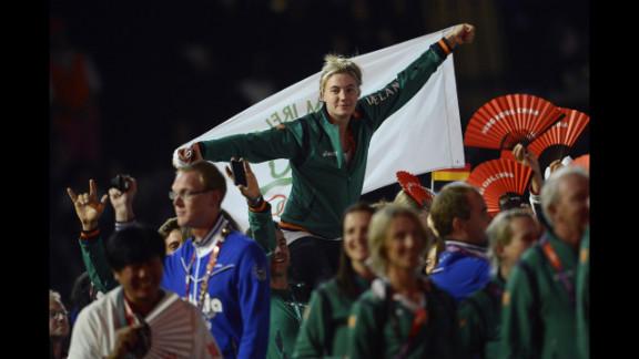 Athletes wave Irish flags at the Olympic stadium.