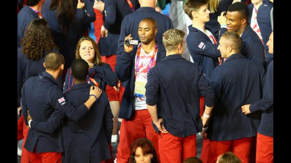 Athlete Mark Lewis-Francis of Great Britain films teammates.