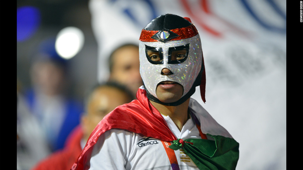 A Mexican athlete wearing a wrestler's mask parades during the closing ceremony.