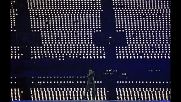 British artist George Michael performs at the Olympic stadium.