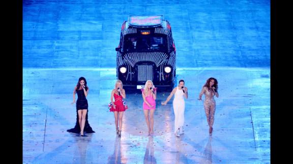 Victoria Beckham, Geri Halliwell, Emma Bunton, Melanie Brown and Melanie Chisholm of The Spice Girls perform.