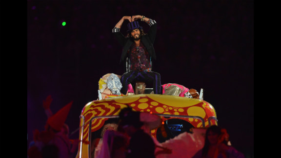 Entertainer Russell Brand performs during the closing ceremony.