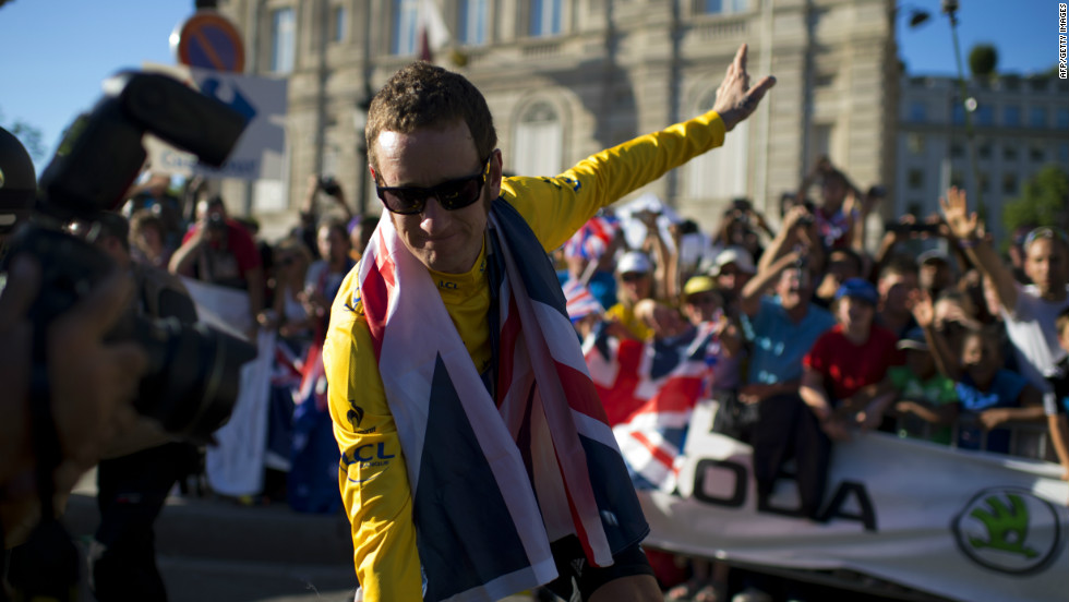 Wiggins lapped up the acclaim on the Champs-Elysees after his landmark victory was confirmed. Thousands of British fans made the trip to Paris to toast his achievement.