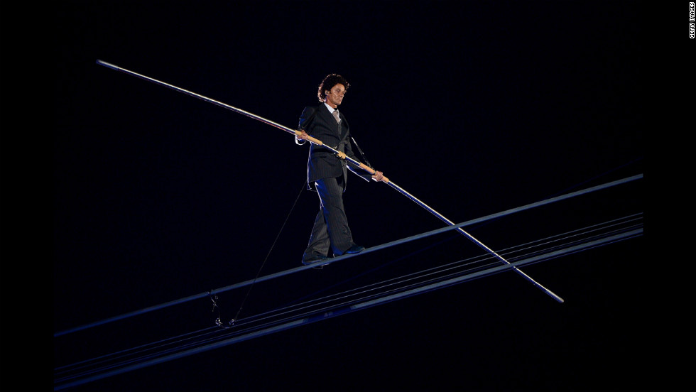 "A high-wire artist performs during a rendition of Pink Floyd's ""Wish You Were Here."""