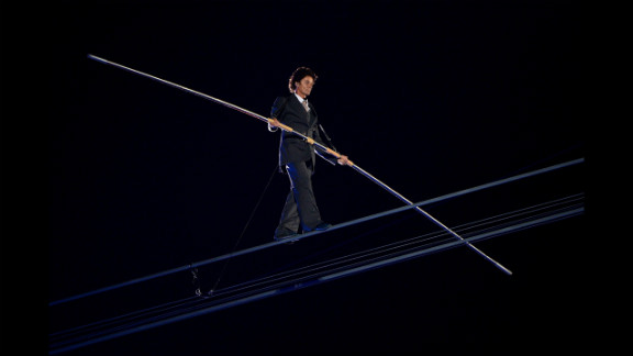 A high-wire artist performs during a rendition of Pink Floyd