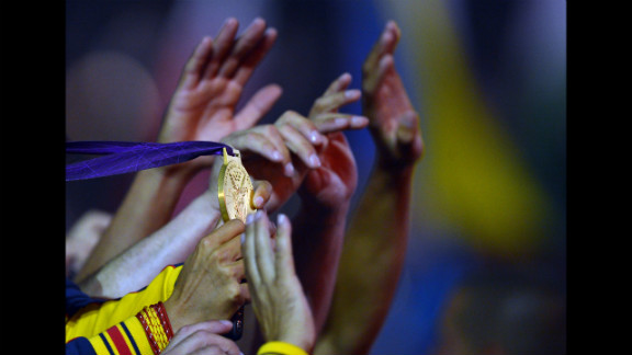 Spain's sailor Marina Alabau Neira shows her gold medal during the closing ceremony.