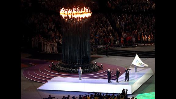 From left, London Mayor Boris Johnson, International Olympic Committee President Jacques Rogge and Rio Mayor Eduardo Paes enter the stadium.
