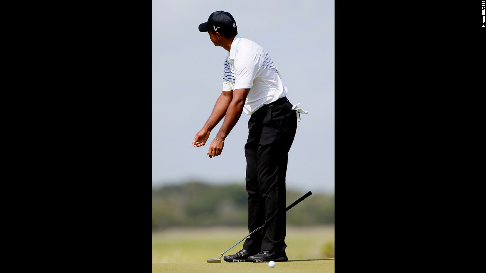 Woods, who dropped significantly in position Saturday, reacts after a missed putt on the fourth green.