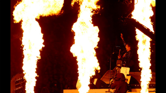 Matthew Bellamy of Muse performs during the closing ceremony.