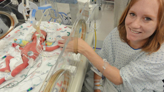 Carrie sits with one of the babies in St. Paul University Hospital