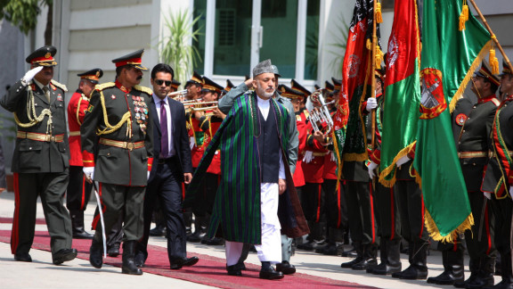 Afghan President Hamid Karzai attends the graduation ceremony of 500 students from the National Police Academy in July.