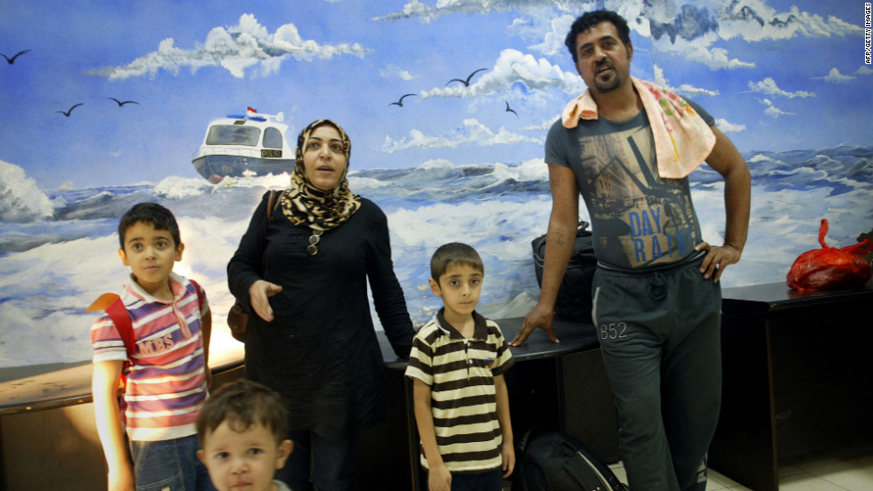 An Australia-bound Iraqi family arrives at an Indonesian marine police station in Surabaya in East Java province on July 29, 2012. They were among a group of 66 Iraqi and Iranian asylum seekers who were rescued from a stricken boat by the Indonesian navy.